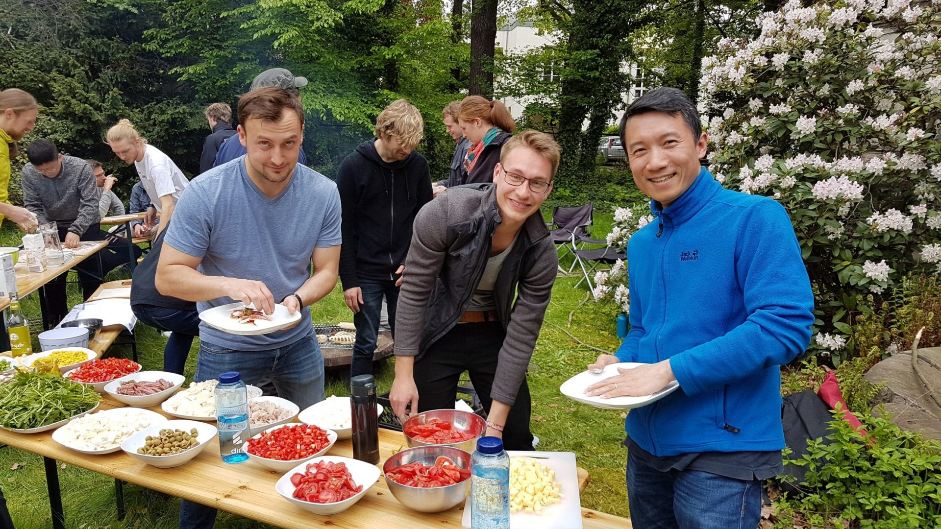 Wandelbots team members on a barbecue